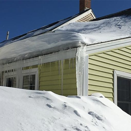 AAA Public Adjusters - Home with snow and ice damage